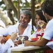 South American man playing guitar for friends — Stock Photo