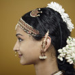 Stock Photo: Indian woman wearing traditional facial jewellery