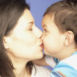 Stock Photo: Studio shot of mother kissing young son