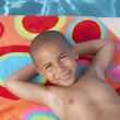 Young boy relaxing on a towel — Stock Photo