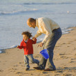 Egyptian father and son on beach — Stock Photo