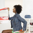 Young woman looking in shoe boxes — Stock Photo