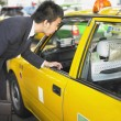 Businessmtalking to cab driver — Stock Photo #13236230