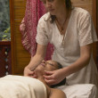 Woman getting massage at spa - Stock Photo