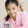 Stock Photo: Portrait of Pacific Islander girl holding cell phone