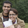 Portrait of Indian couple hugging — Stock Photo