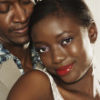 Close up of African couple hugging — Stock Photo #13236299