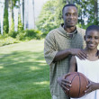 Portrait of father and son with basketball — Stock Photo