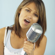 Indiwomsinging into microphone — Stock Photo #13236332