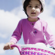Preschool girl riding bicycle — Stock Photo #13236351