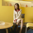 Businesswoman sitting in waiting room — Stock Photo