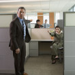 Business pointing at each other in office cubicles - Foto Stock