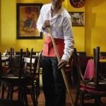 Portrait of man mopping restaurant floor — Stock Photo #13236426