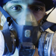Headshot of man wearing gas mask — Stock Photo