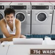 Portrait of man in tank top at laundromat — Stock Photo
