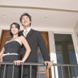 Portrait of couple on balcony — Stock Photo