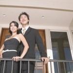 Portrait of couple on balcony — Stock Photo