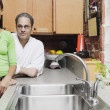 Portrait of couple standing in kitchen — Foto de Stock