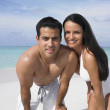 Stock Photo: Couple smiling on the beach