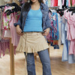 Hispanic teenaged girl shopping for clothing - Foto de Stock  