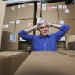 Frustrated businessman in warehouse  — Stockfoto