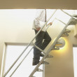 Businessman climbing stairs — 图库照片