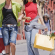 Hispanic women carrying shopping bags — Stock Photo #13236669