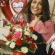 Hispanic female florist making Valentine's Day arrangement — Stock Photo