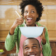 African American couple baking in kitchen — Stock Photo #13236724