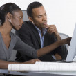 Partners working on computer together in office — Stock Photo
