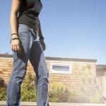 Low angle portrait of teenage girl on skateboard — Stock Photo