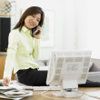 Businesswoman working at her desk — Stock Photo #13236865