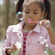 AfricAmericgirl blowing bubbles — Stock Photo #13236870