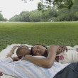 Couple relaxing on a picnic blanket outdoors — Stock Photo