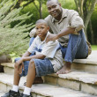 Stock Photo: Father and son sitting on steps
