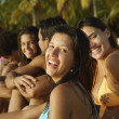 South American friends sitting on beach — Stock Photo #13236929