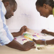 Young man and woman viewing color swatches - Stock Photo