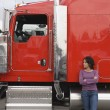 Young woman standing by her truck - Stock Photo