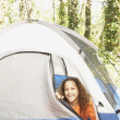 AfricAmericgirl peeking out of tent — Stock Photo #13236958