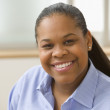 Close up of African American woman smiling — Stock Photo