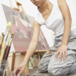 Female artist paiting — Stock Photo #13237021