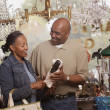 Couple shopping in antique shop — Stock Photo #13237112
