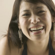 Close up portrait of woman laughing — Stock Photo