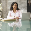 Businesswoman working at her desk — Stock Photo #13237166