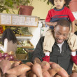 African American father with young son on shoulders in supermarket - Stock Photo