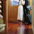 Couple kissing at door - Stock Photo