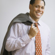 Stock Photo: African American businessman with jacket over shoulder