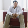 African American man sitting in chair — Stock Photo