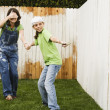 Stock Photo: Mother and daughter painting fence
