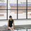 Female Asian swimmer with legs in pool — Stock Photo